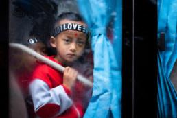China Yunnan Trauriger Junge Bus